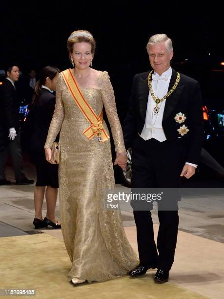 King Philippe of Belgium and Queen Mathilde of Belgium arrive to attend the Court Banquet at the Imperial Palace on October 22, 2019 in Tokyo, Japan.