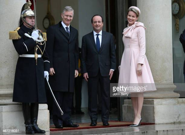 King Philippe of Belgium and Queen Mathilde of Belgium meet French President Francois Hollande during a one day official visit in Paris at the Elysee...