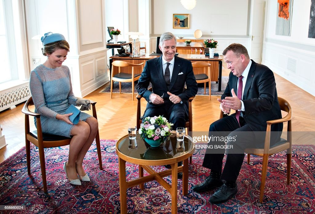 King Philippe of Belgium (C) and Queen Mathilde of Belgium (L) meet with Danish Prime Minister Lars Lokke Rasmussen (R) in his office in Copenhagen March 28, 2017. The Belgian Royal Couple is on a two days state visit in Denmark. / AFP PHOTO / Scanpix Denmark / Henning Bagger / Denmark OUT