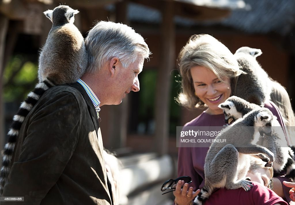 King Philippe of Belgium and Queen Mathilde of Belgium pictured with a lemur during a photoshoot of the Belgian Royal Family's vacation at animal park Pairi Daiza in Cambron-Casteau, Brugelette, on July 11, 2015.