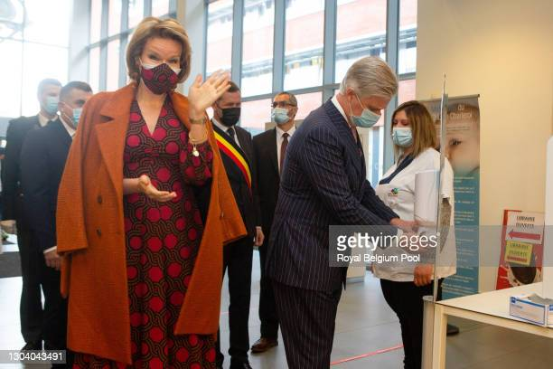 King Philippe of Belgium and Queen Mathilde of Belgium visit the Marie Curie Civil Hospital on February 25, 2021 in Lodelinsart, Belgium. The Royal...