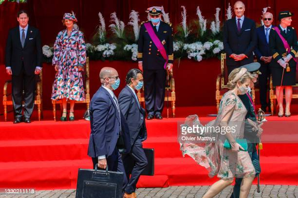 King Philippe of Belgium and Queen Mathilde pass in front of Jim O'Hare, Princess Delphine, Prince Laurent of Belgium, Prince Lorenz and Princess...