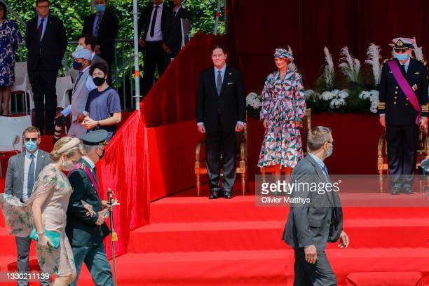 King Philippe of Belgium and Queen Mathilde pass in front of Jim O'Hare, Princess Delphine and Prince Laurent of Belgium during the ceremony in front...