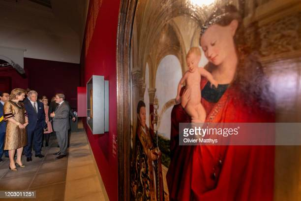 """King Philippe of Belgium and Queen Mathilde pose in front of the Maelbeke Madonna during a visit to the """"Van Eyck an Optical Revolution"""" exhibition..."""