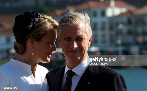 King Philippe of Belgium and Queen Mathilde pose next to the Douro River in downtown Porto, on October 24 on the third day of their official visit to...