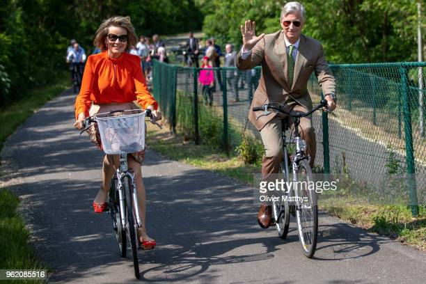 King Philippe of Belgium and Queen Mathilde ride a bike during a visit to the province of Limbour on May 24 2018 in Limbourg Belgium