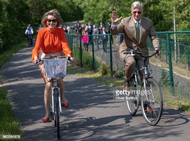 King Philippe of Belgium and Queen Mathilde ride bikes during a visit to the province of Limbour on May 24 2018 in Limbourg Belgium