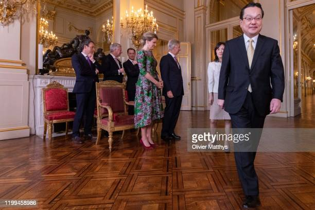 King Philippe of Belgium and Queen Mathilde welcome Ambassador of Japan Makita Shimokawa and Spouse during a New Year's Reception for Heads of...