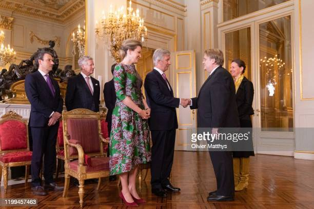 King Philippe of Belgium and Queen Mathilde welcome Ambassador of the Federal Republic of Germany Martin Kotthaus and Spouse during a New Year's...