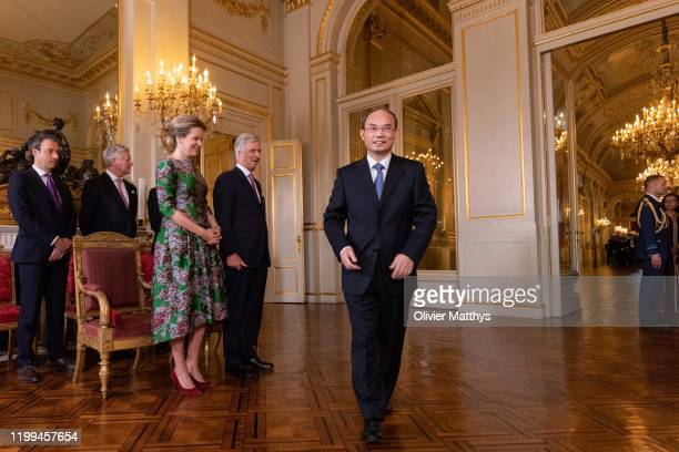 King Philippe of Belgium and Queen Mathilde welcome Ambassador of the People's Republic of China Zhongming Cao during a New Year's Reception for...