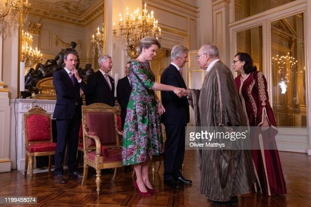 King Philippe of Belgium and Queen Mathilde welcome Ambassador of the Republic of Tunisia Ridha Ben Mosbah during a New Year's Reception for Heads of...