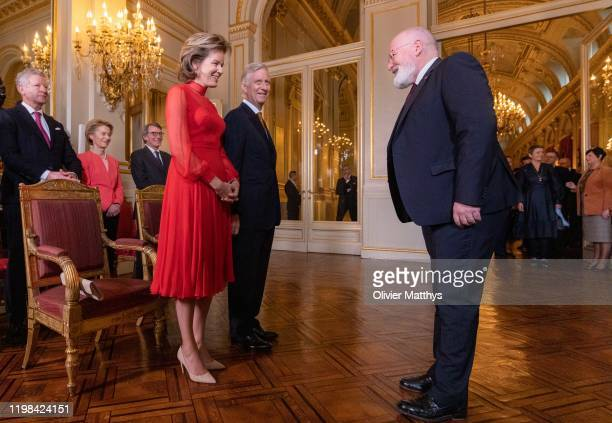 King Philippe of Belgium and Queen Mathilde welcome European Commission vicechairman Frans Timmermans during the New Year's reception for Heads of...