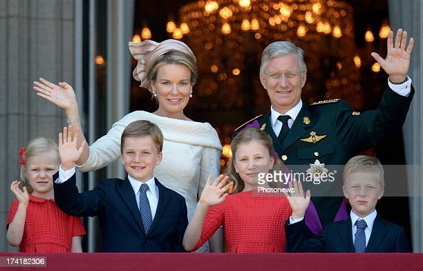 King Philippe of Belgium and Queen Mathilde with children Princess Eleonore Prince Gabriel Princess Elisabeth and Prince Emmanuel greet the audience...