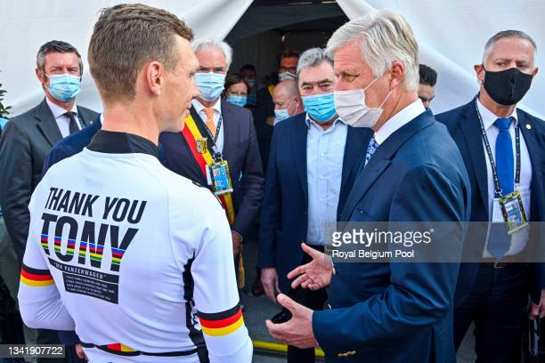 King Philippe of Belgium congratulates Tony Martin of the winning German Cycling Team during the UCI 2021 Road World Championships Flanders Belgium...
