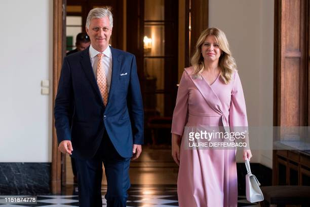 King Philippe of Belgium Filip of Belgium walks with Slovakia's President Zuzana Caputova during a meeting at the Royal Palace in Brussels on June 25...