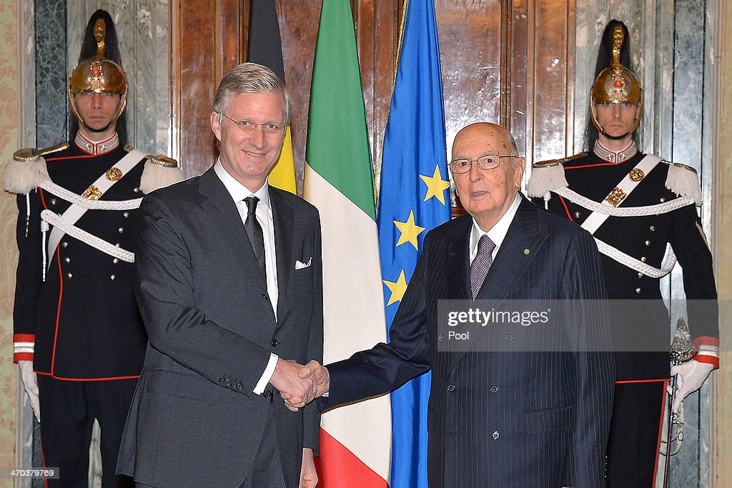 King Philippe of Belgium (L) greets Italian President Giorgio Napolitano as he arrives at Quirinale Palace on February 19, 2014 in Rome, Italy.
