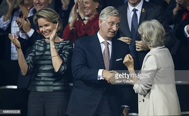 King Philippe of Belgium greets The Duchess of Gloucester while Queen Mathilde of Belgium applauds following the victory of David Goffin of Belgium...