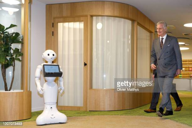 King Philippe of Belgium interacts with Bot Nora at the Artificial Intelligence section of the Department of Social Security RSZ/ONSS on February 18...