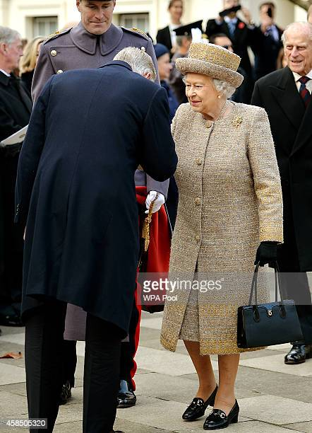 King Philippe of Belgium kisses the hand of Queen Elizabeth II as they attend the opening of the Flanders' Fields Memorial Garden on November 6 2014...