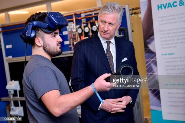 King Philippe of Belgium listens on during a visit to the T2 Technologie en Talent campus in Genk on January 29 2019 The T2 campus is a project of...