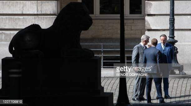 King Philippe of Belgium , N-VA chairman Bart De Wever and PS chairman Paul Magnette speak after a meeting at the Royal Palace in Brussels on July 20...