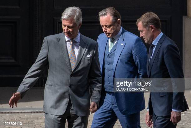 King Philippe of Belgium, N-VA chairman Bart De Wever and PS chairman Paul Magnette arrive for a meeting at the Royal Palace in Brussels on July 20...