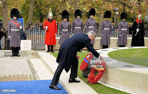 King Philippe of Belgium places a wreath of poppies at the new Flanders Field Memorial outside the Guards Chapel on November 6 2014 in London England