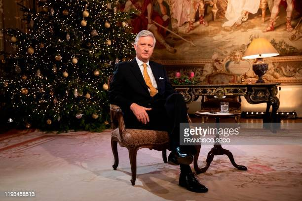 King Philippe of Belgium poses during the recording of his yearly Christmas message and nea year wishes at the Royal Palace in Brussels on December...