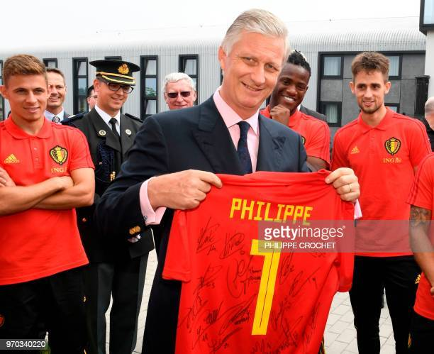 King Philippe of Belgium poses with a Red Devils shirt during a visit to the a training session of the Belgian national football team Red Devils, on...