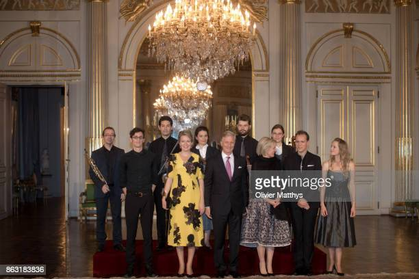 King Philippe of Belgium Queen Mathilde of Belgium and Princess Astrid of Belgium pose with the musicians after a concert to honor young talents in...