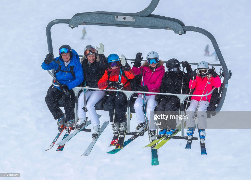 King Philippe of Belgium, Queen Mathilde of Belgium, Prince Gabriel, Princess Elisabeth, Prince Emmanuel and Princess Eleonore wave from a ski lift during their ski holidays on February 12, 2018 in Verbier, Switzerland.