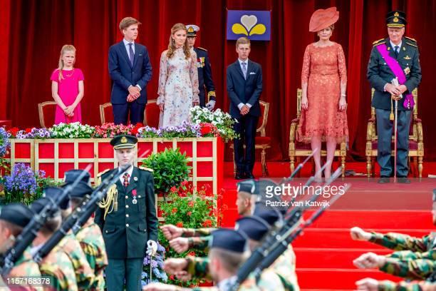 King Philippe of Belgium Queen Mathilde of Belgium Princess Elisabeth of Belgium and Prince Gabriel of Belgium attend the military parade during...