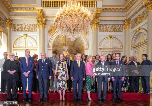 King Philippe of Belgium, Queen Mathilde, Prince Laurent and Princess Astrid pose with the international Queen Elisabeth Music Concurs members of the...