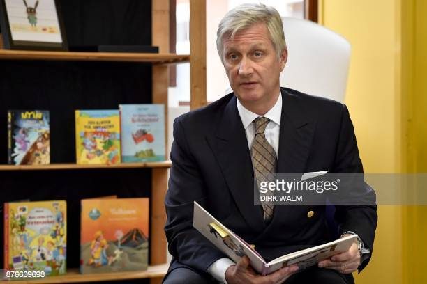 King Philippe of Belgium reads a story at the start of the 'Voorleesweek - La semaine de la lecture' , on November 20 at a primary school 'De...