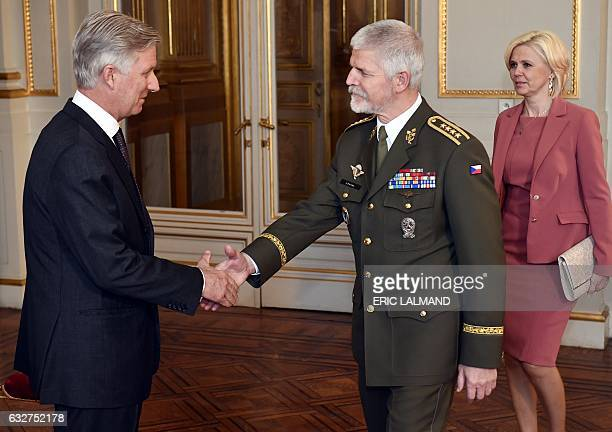 King Philippe of Belgium shakes hands with Chairman of the NATO Military Committee General Petr Pavel during a New Year's reception organized by the...