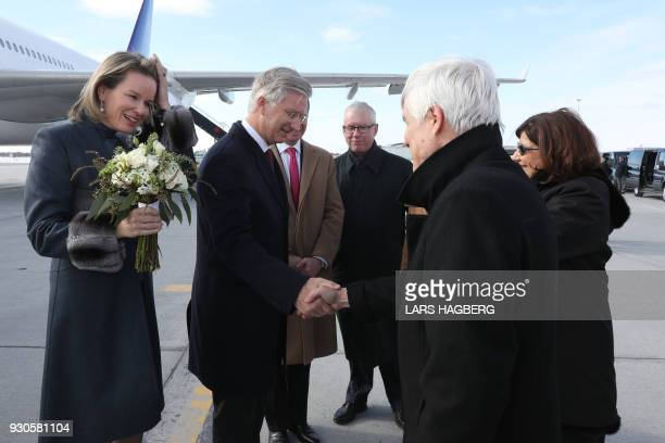 King Philippe of Belgium shakes hands with Olivier Nicoloff Ambassador of Canada to Belgium after the royal couple arrived at Ottawa International...