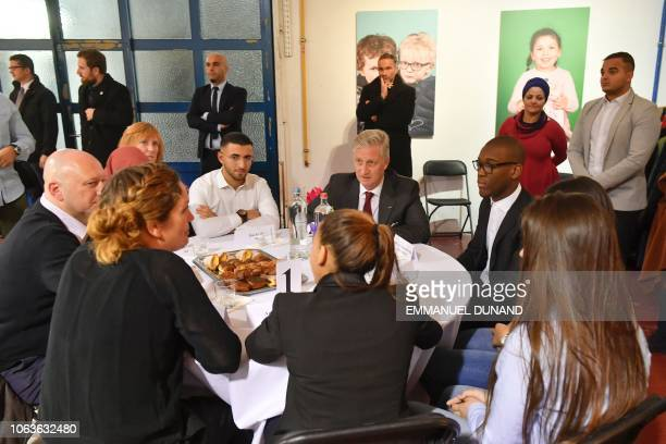 King Philippe of Belgium speaks with inhabitants of the Brussels district of Molenbeek at the cultural center LaVallee a 6000 squaremetre coworking...