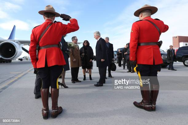 King Philippe of Belgium speaks with Raoul Delcorde Ambassador of Belgium to Canada after arriving at Ottawa International Airport in Ottawa Ontario...