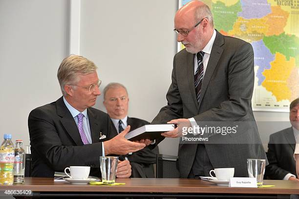 King Philippe of Belgium talks to Guy Rapaille President of the Comite R/I in charge of Intelligence Services during his visit to the Comite R/I to...