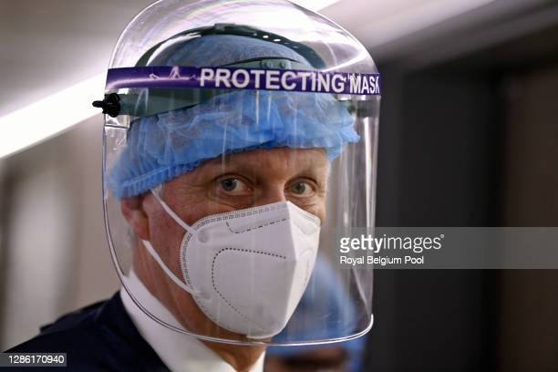 King Philippe of Belgium visits the Bois de l'Abbaye Hospital Center, on November 17, 2020 in Charleroi, Belgium. The Royal Couple met with staff...