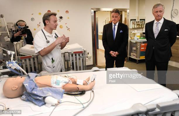 King Philippe of Belgium visits the extended COVID19 unit at the University Hospital UZ Jette on April 08 2020 in Brussels Belgium The Belgian...