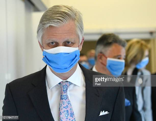 King Philippe of Belgium wears a protective mask as he visits the extended COVID19 unit at the University Hospital UZ Jette on April 08 2020 in...