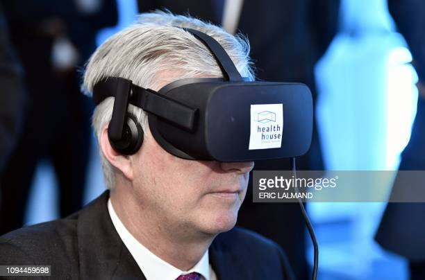 King Philippe of Belgium wears Virtual Reality glasses during a visit to 'Health House' a center where visitors can experience new technologies in...