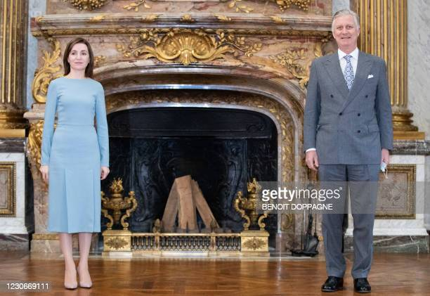 King Philippe of Belgium welcomes Moldavia's President Sandu for an audience at the Royal Palace in Brussels on January 19, 2021. / Belgium OUT