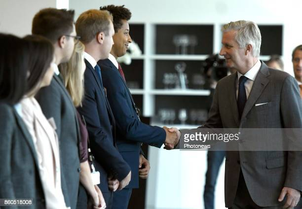 King Philippe pictured visiting the office of Brussels Airport Philippe shaking hands with workers of Brussels Airport