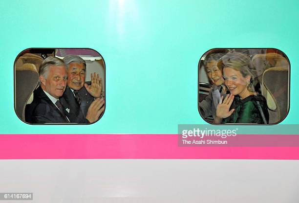 King Philippe Queen Mathilde of Belgium Emperor Akihito and Empress Michiko wave to media from Shinkansen bullet train on the way to Yuki at Tokyo...