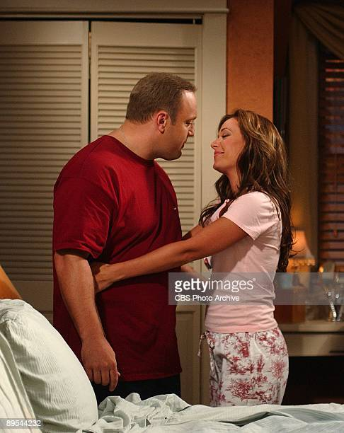 """King Pong"""" - Doug and Carrie embrace after a heated ping-pong match , on The King of Queens, scheduled to air on the CBS Television Network."""
