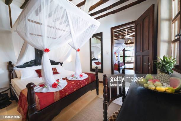 king size bed with mosquito net - tradition stock pictures, royalty-free photos & images