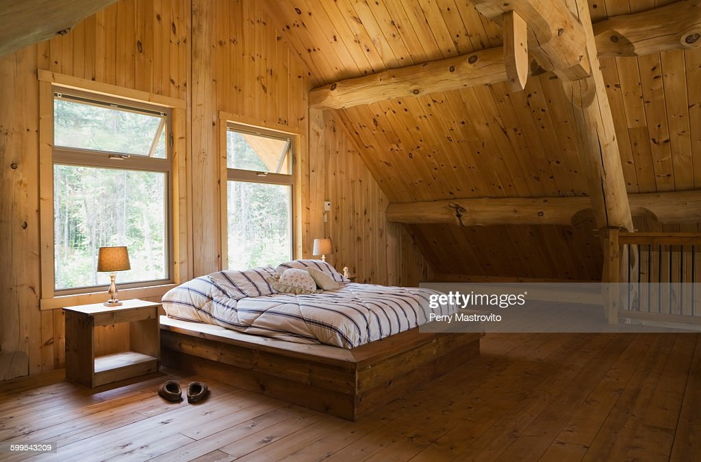 King Size Bed With Wooden Bed Frame In The Master Bedroom On Mezzanine Inside A Handcrafted Eastern White Pine Cottage Style Log Home Quebec Canada Foto De Stock Getty Images