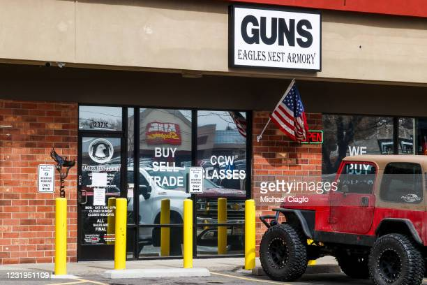 King Soopers grocery store, not connected to Monday's shooting, is reflected in the window of the Eagles Nest Armory on March 26, 2021 in Arvada,...
